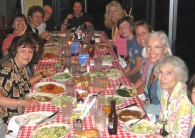 L to R: Bob Mason, Diane Mason, Susan Fox (hiding), Karryl, Linda Rubin, Don Rubin, Kathleen Sheard, Rachelle Siegrist, Kelly Singleton, Joni Johnson-Godsy, Joy Kroeger Beckner, Marilyn Newmark and Mindy Maylett delight in an Italian Feast on Friday evening.