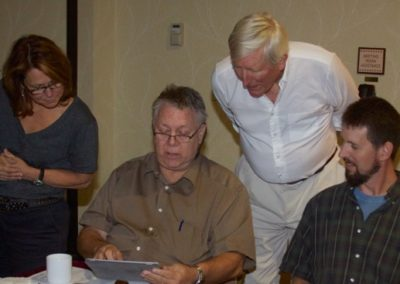 Renée Bemis, Allen Blagden, David Rankin and Sean Murtha discuss digital books during a break at the Board meeting