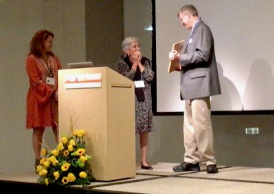 "Executive Director, Wes Siegrist, presents the Lifetime Achievement Award to his ""Art Mom"", Janet N. Heato"